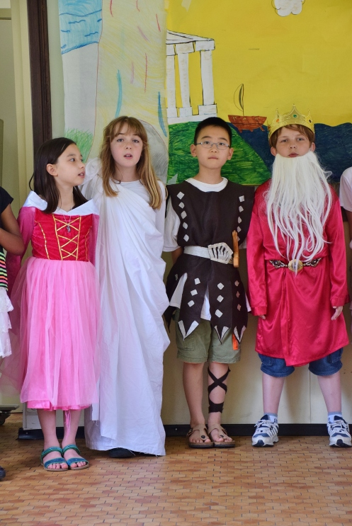 Greek play+last minute, parent provided costumes=unintentional humor.